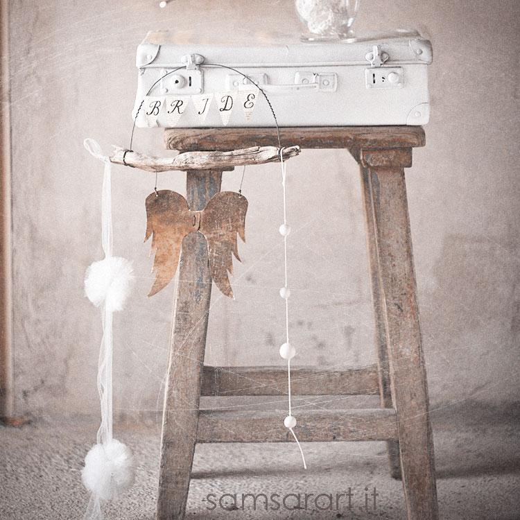Decorazione per matrimonio in legno e ali in metallo