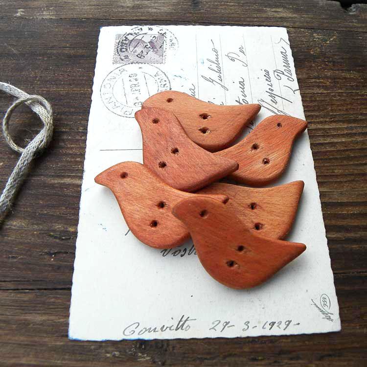 Bottoni a forma di uccellino