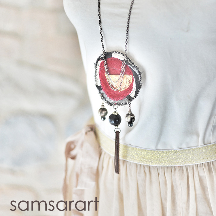 Necklace with textile pendant